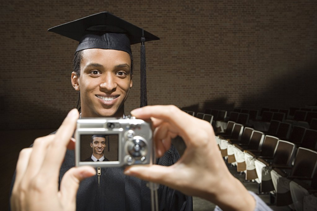 Male graduate being photographed : Stock Photo