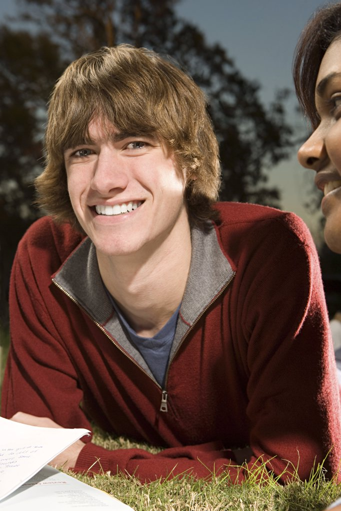 Two students studying outdoors : Stock Photo