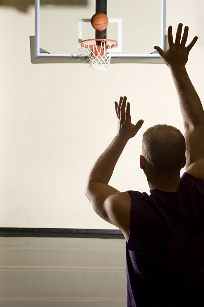 Stock Photo: 1439R-1007285 Man playing basketball