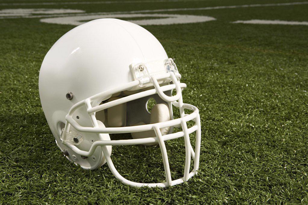 Stock Photo: 1439R-1007322 Helmet on american football field