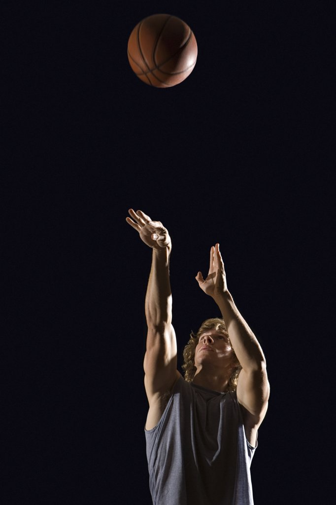 Man throwing basketball : Stock Photo