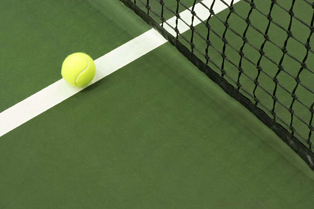 Stock Photo: 1439R-1007752 Tennis ball on court