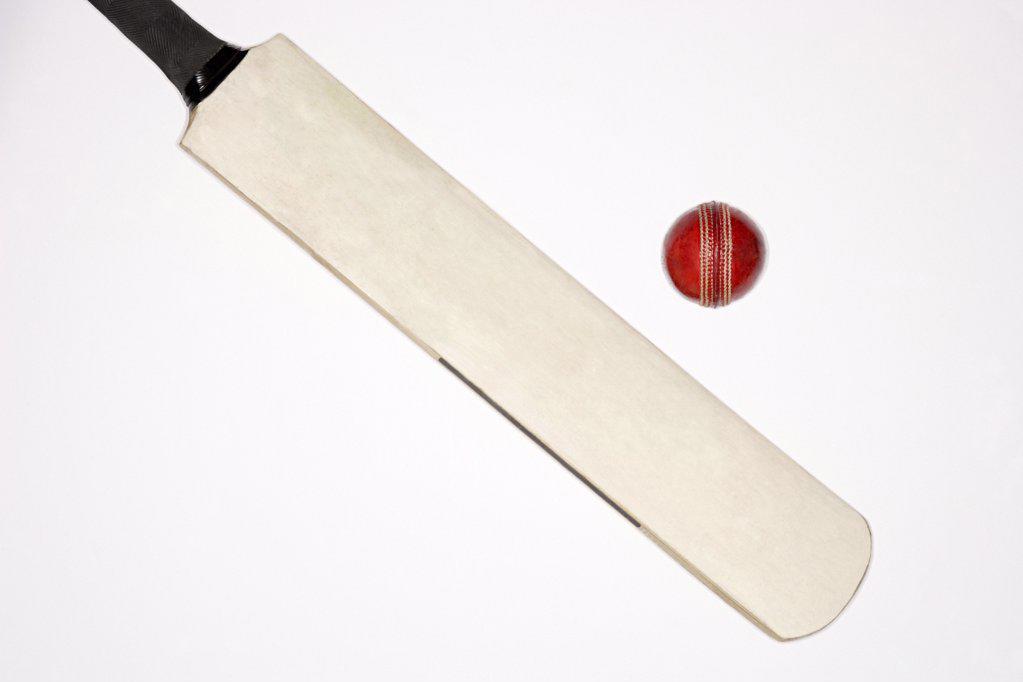 Stock Photo: 1439R-1007801 Cricket bat and ball