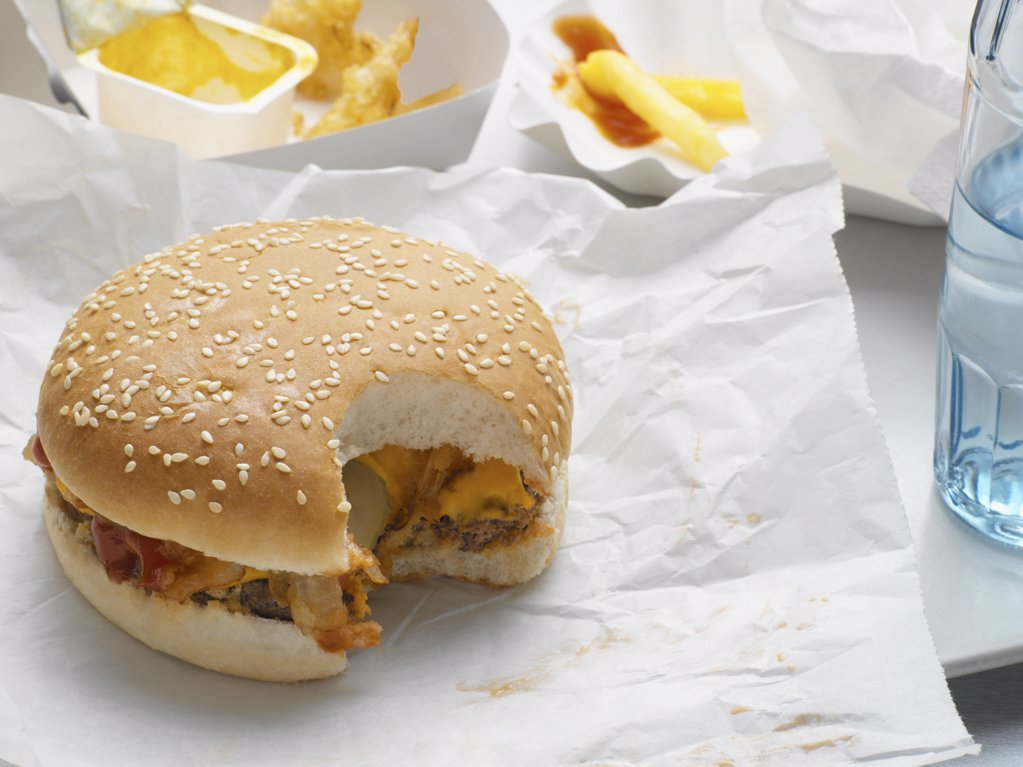 Cheeseburger with missing bite : Stock Photo