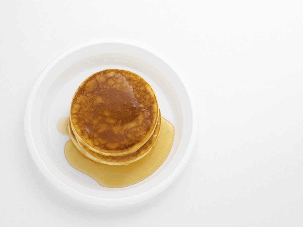 Stock Photo: 1439R-1009101 Pancakes with maple syrup
