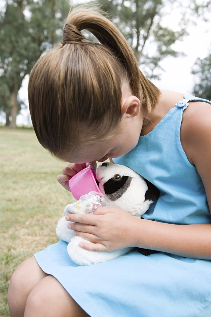Girl playing with a soft toy : Stock Photo