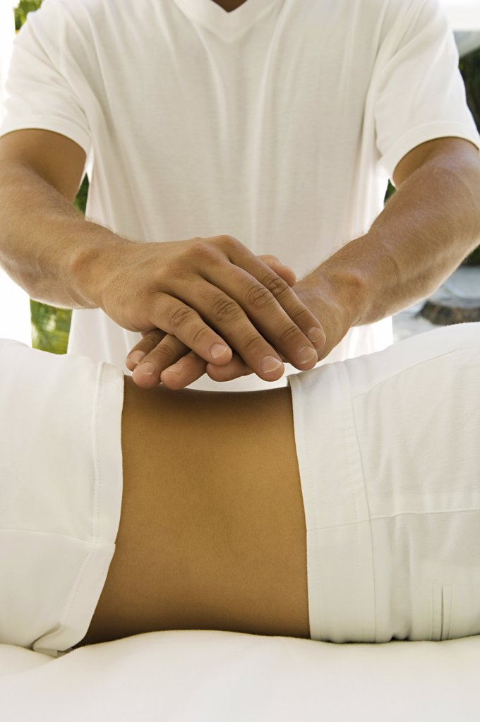 Stock Photo: 1439R-1010474 Woman having reiki treatment