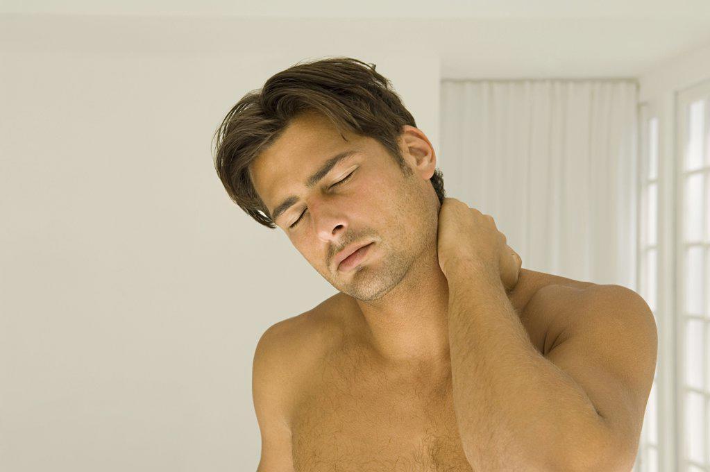Man rubbing his neck : Stock Photo