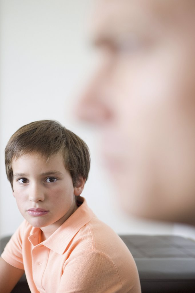 Boy and blurred father : Stock Photo