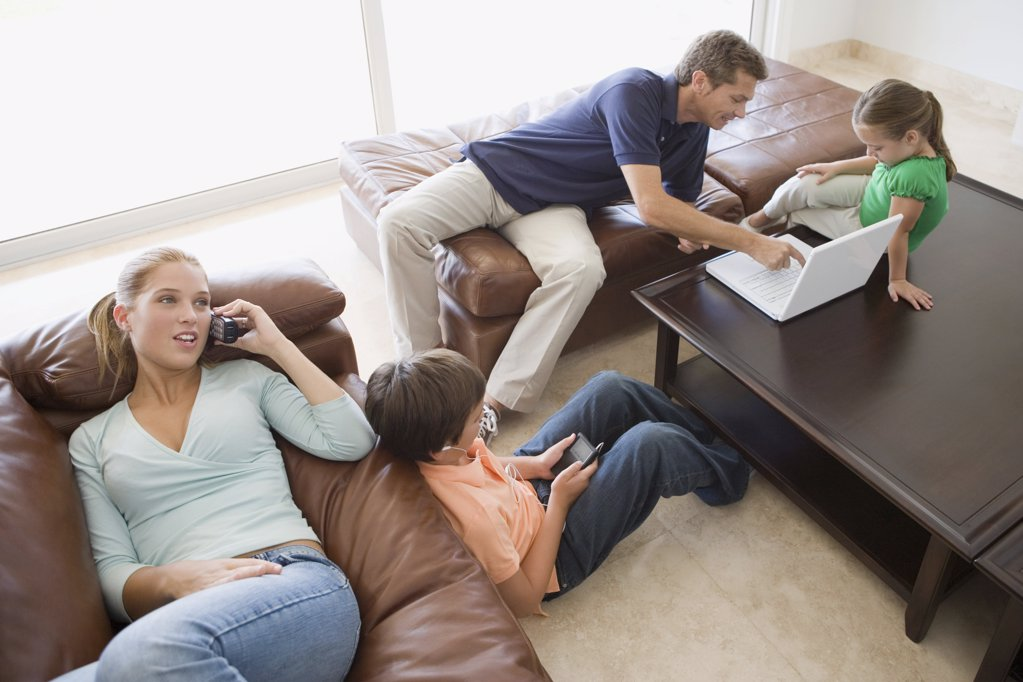 Family with different technologies : Stock Photo