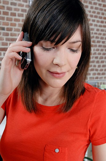 Woman using a cellular telephone : Stock Photo