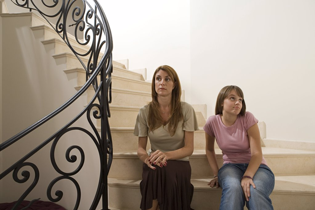 Mother and daughter on stairs : Stock Photo