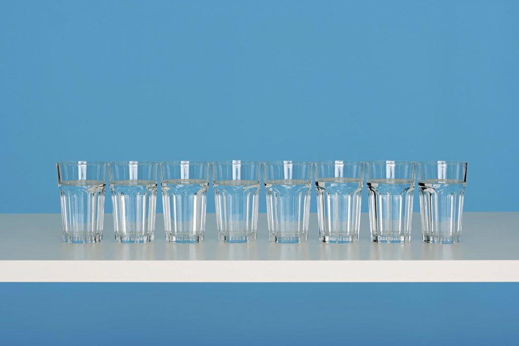Eight glasses of water : Stock Photo