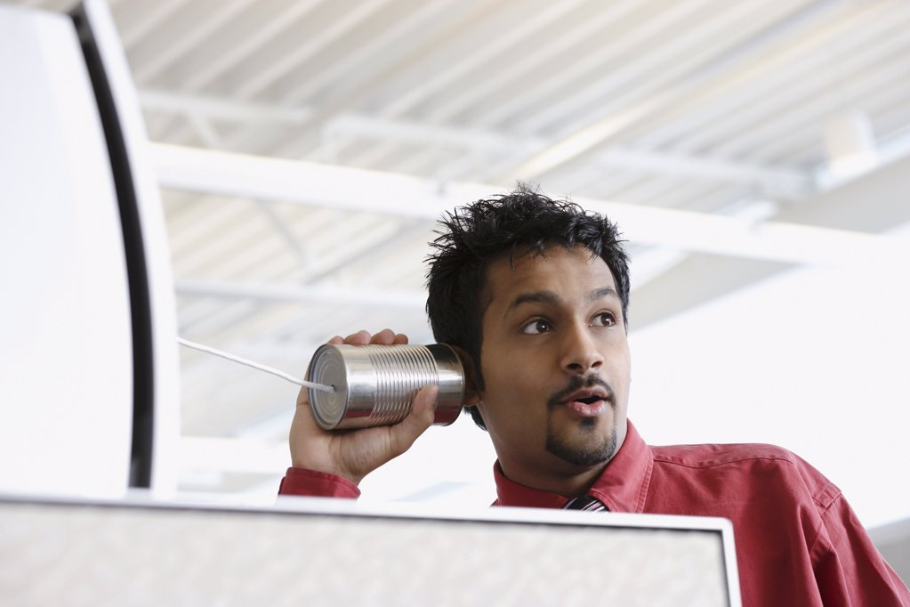 Stock Photo: 1439R-1012660 Man using a tin can telephone