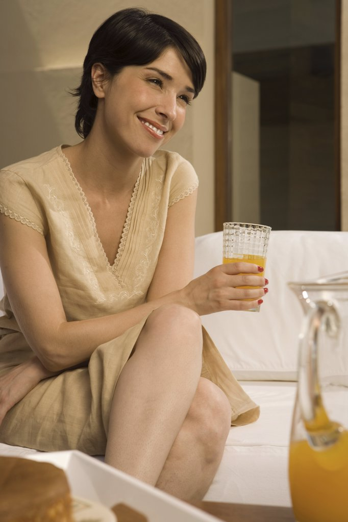 Woman with glass of orange juice : Stock Photo
