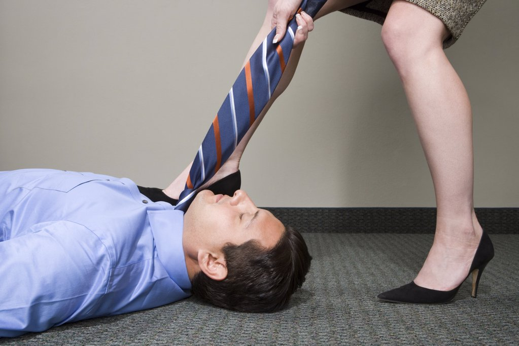 Stock Photo: 1439R-1014956 Woman pulling manager's tie