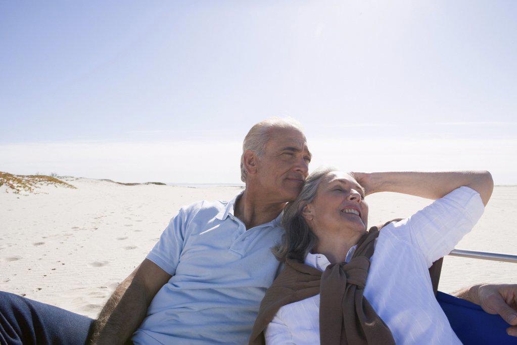 Senior couple relaxing on beach : Stock Photo