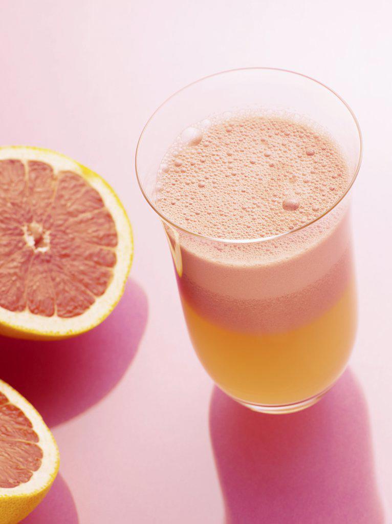 Stock Photo: 1439R-1015463 Pink grapefruit juice