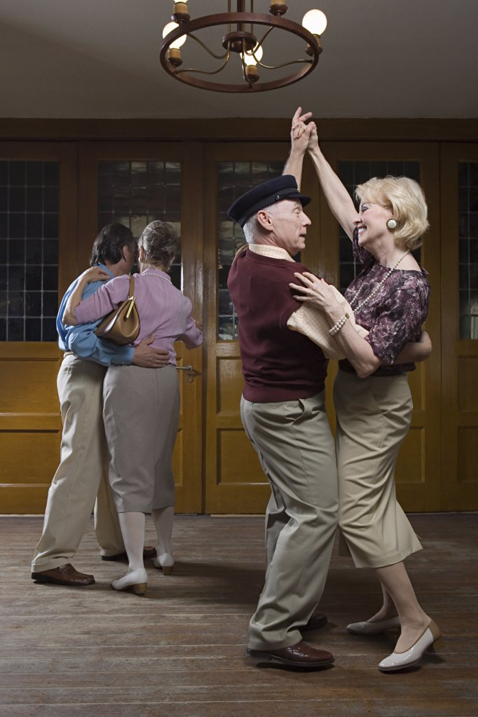 Stock Photo: 1439R-1015525 Senior couples dancing