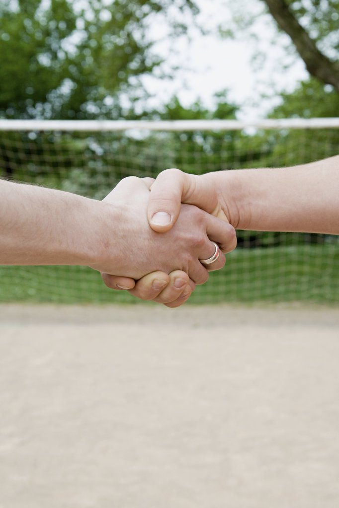 Footballers shaking hands : Stock Photo