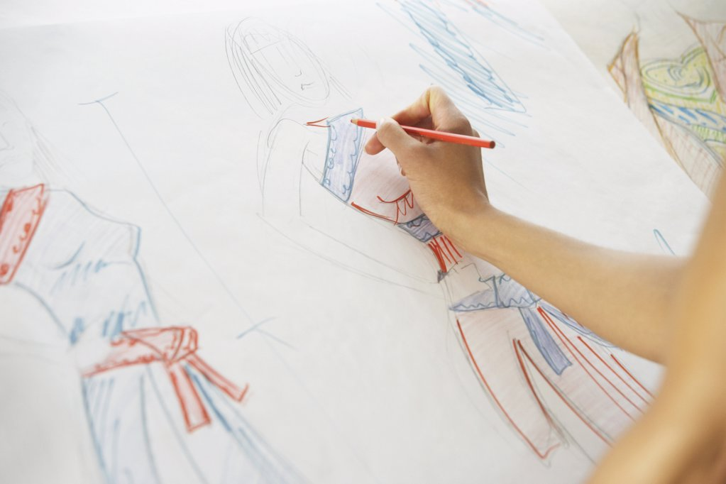 Drawing fashion designs : Stock Photo