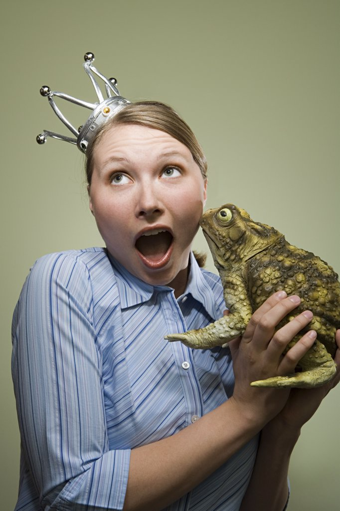 Stock Photo: 1439R-1016511 Office worker holding a frog