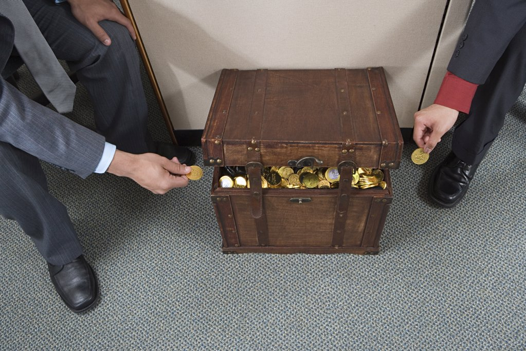 Stock Photo: 1439R-1016523 Colleagues taking money