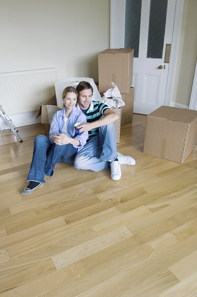 Couple in their new home : Stock Photo