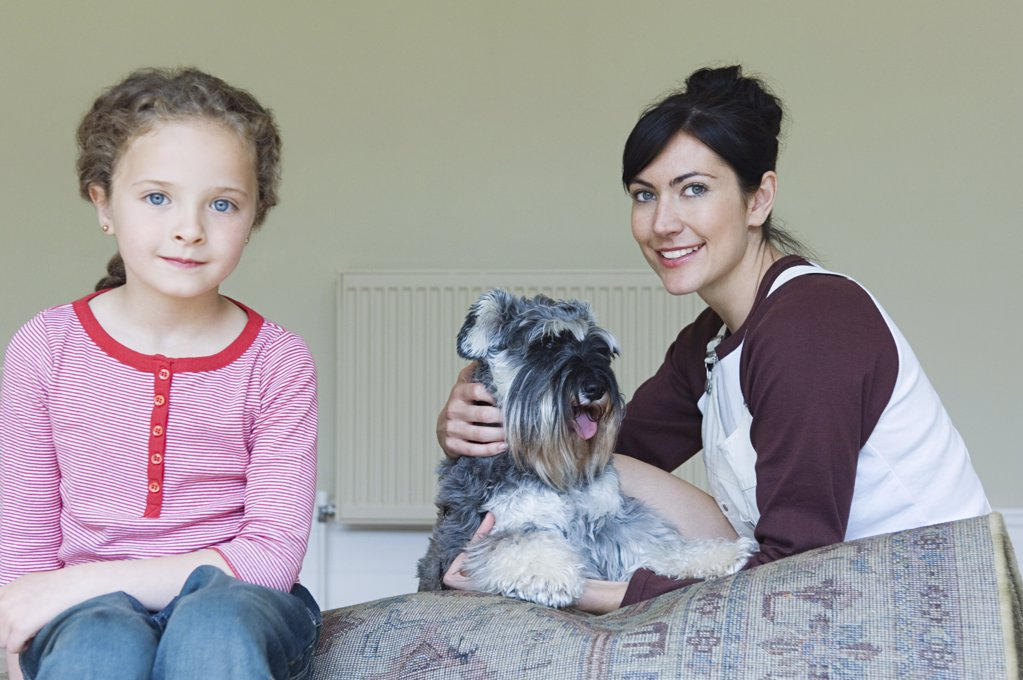 Mother and daughter with pet dog : Stock Photo