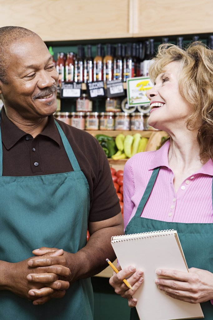Two shop assistants : Stock Photo