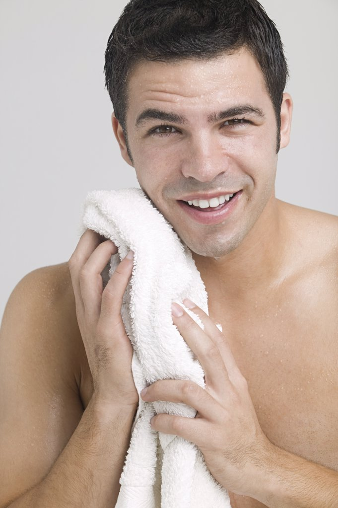 Man drying his face : Stock Photo
