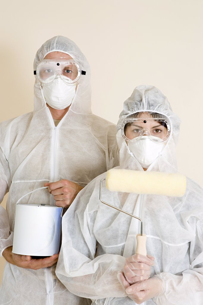 Man and woman ready for decorating : Stock Photo