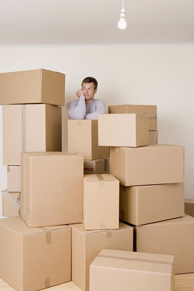 Man with stack of cardboard boxes : Stock Photo