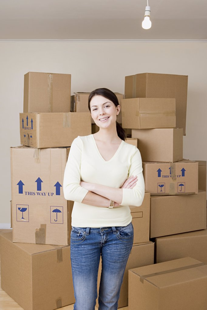 Stock Photo: 1439R-1019901 Woman with cardboard boxes