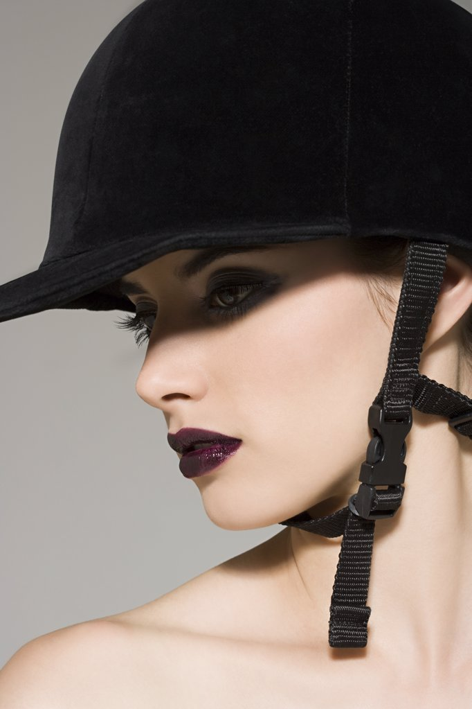 Stock Photo: 1439R-1019941 Woman in a riding hat