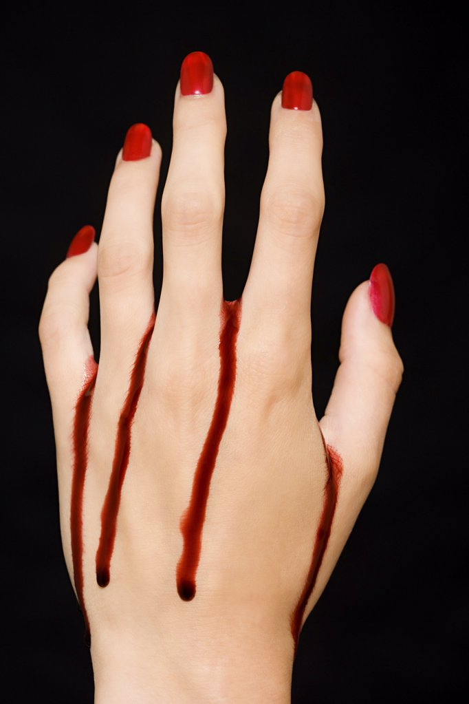 Female hand with blood : Stock Photo