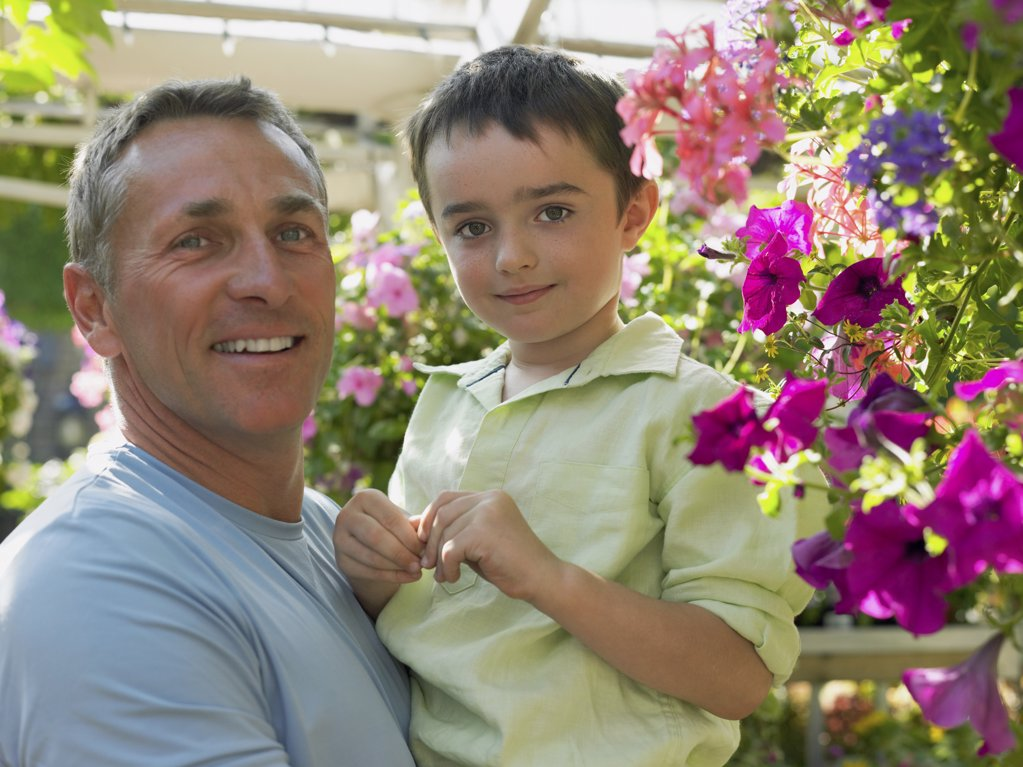 Stock Photo: 1439R-1024894 Father holding son in garden centre