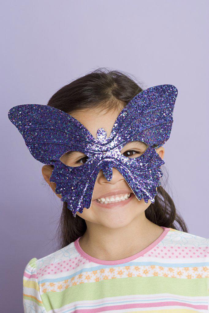 Girl wearing a butterfly eye mask : Stock Photo