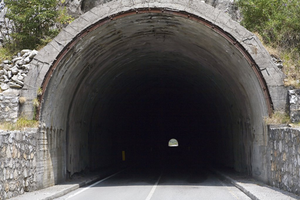 Road going into a tunnel : Stock Photo