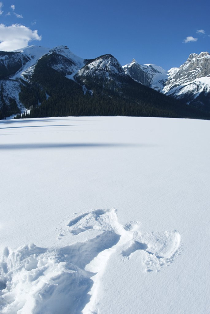 Stock Photo: 1439R-1028332 Snow angel on emerald lake
