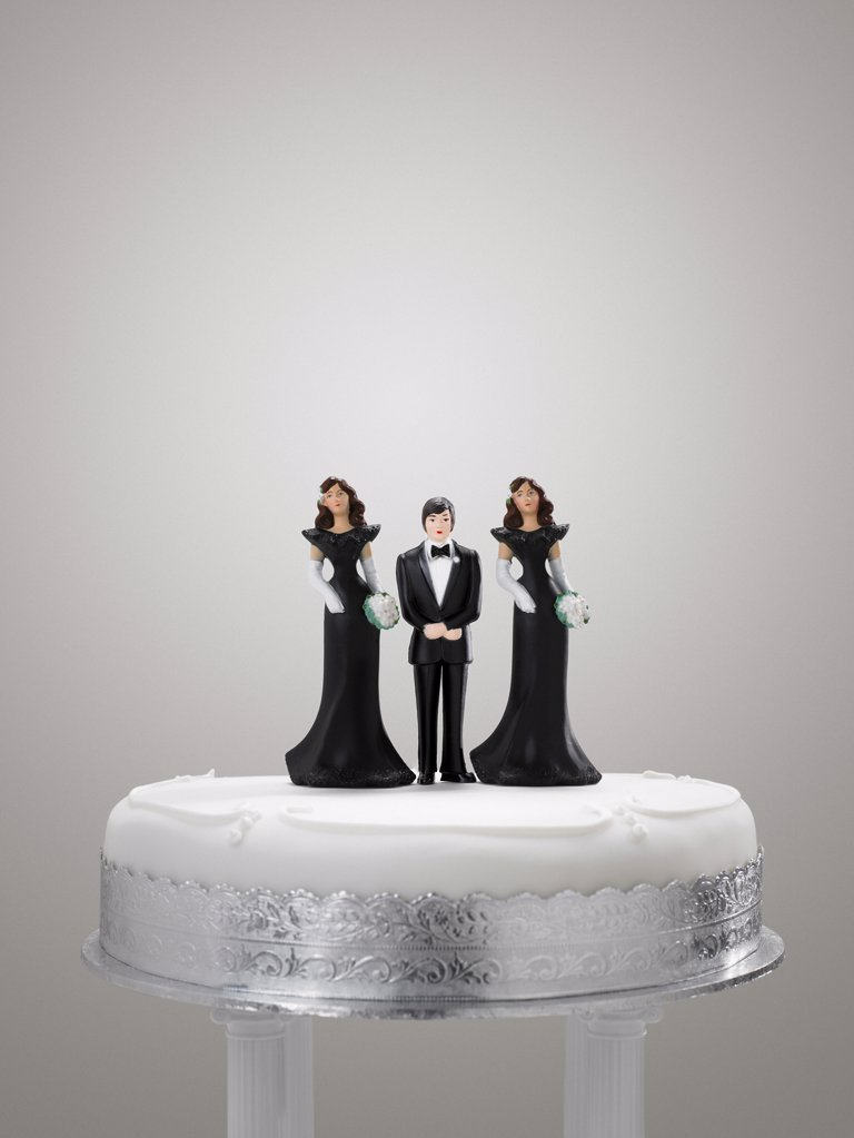 Stock Photo: 1439R-1028790 Bridegroom and bridesmaid figurines on a wedding cake