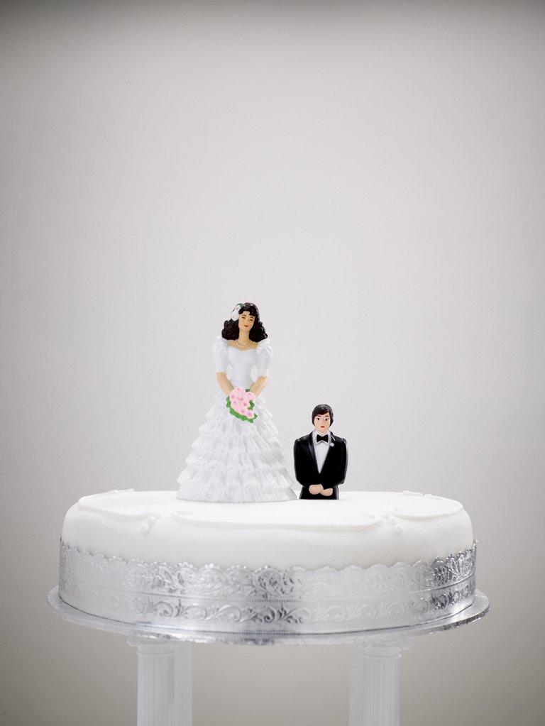 Stock Photo: 1439R-1028813 Bride and bridegroom figurines on a wedding cake