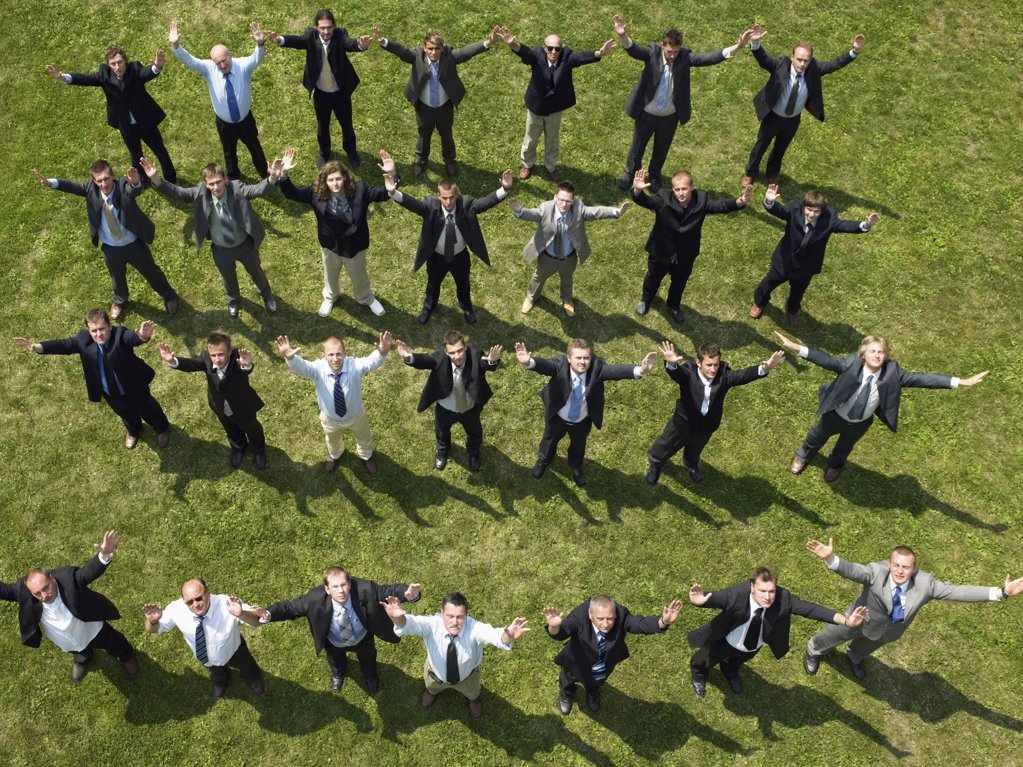 Businessmen with their arms in the air : Stock Photo