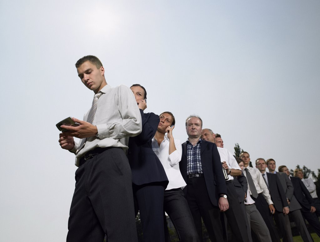 Businesspeople waiting in a queue : Stock Photo