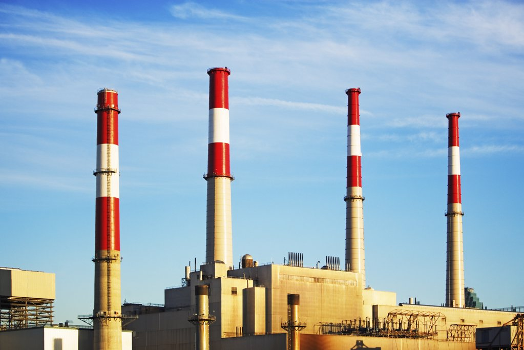 Industrial plant with smokestacks : Stock Photo