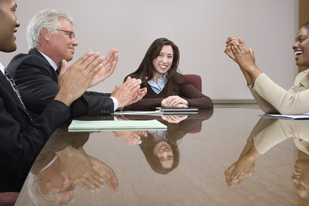 Stock Photo: 1439R-1030496 People clapping colleague