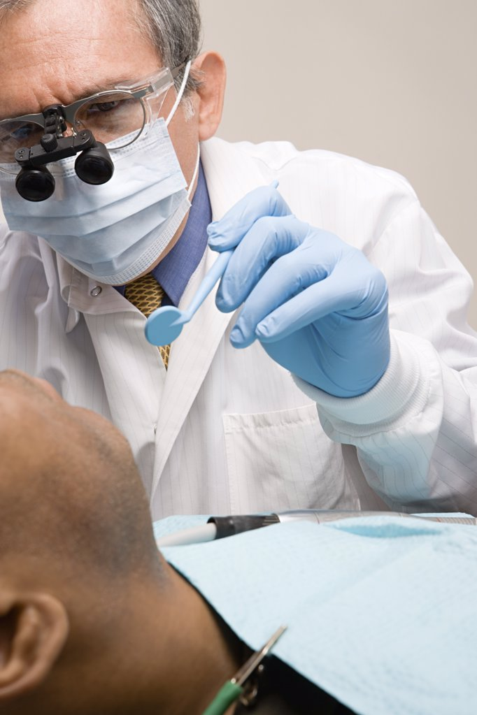 Man having teeth examined : Stock Photo