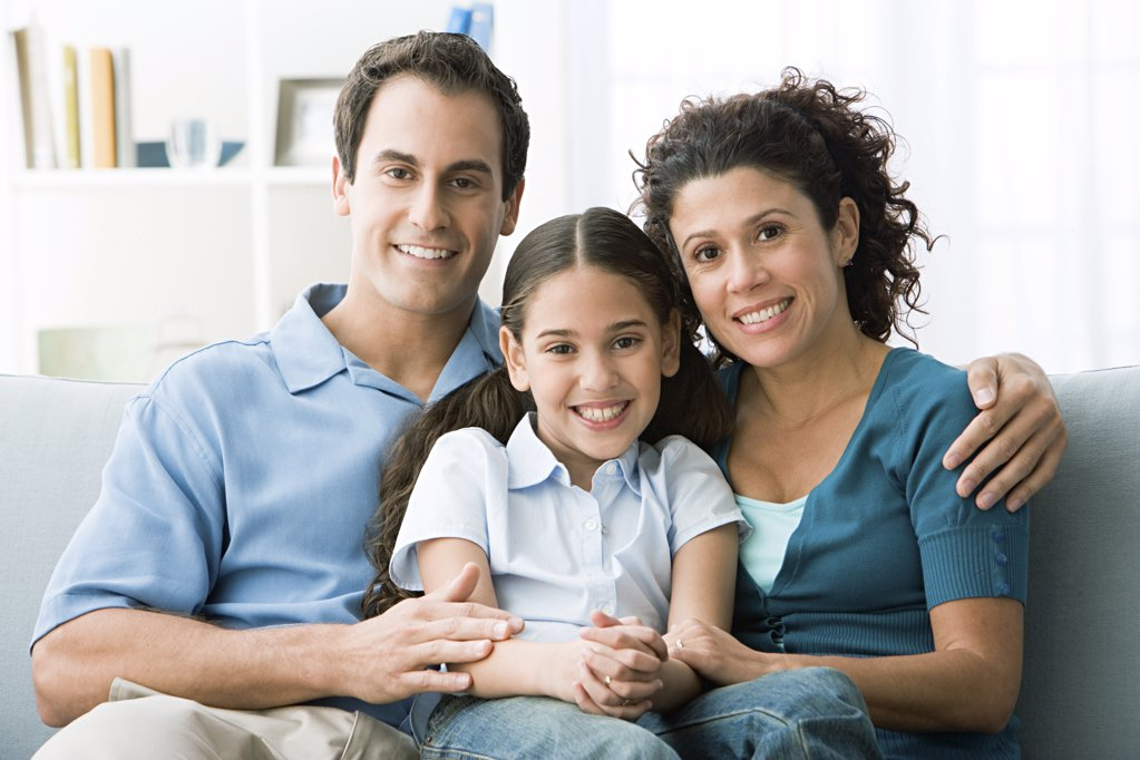Stock Photo: 1439R-1031053 Family sitting on a sofa
