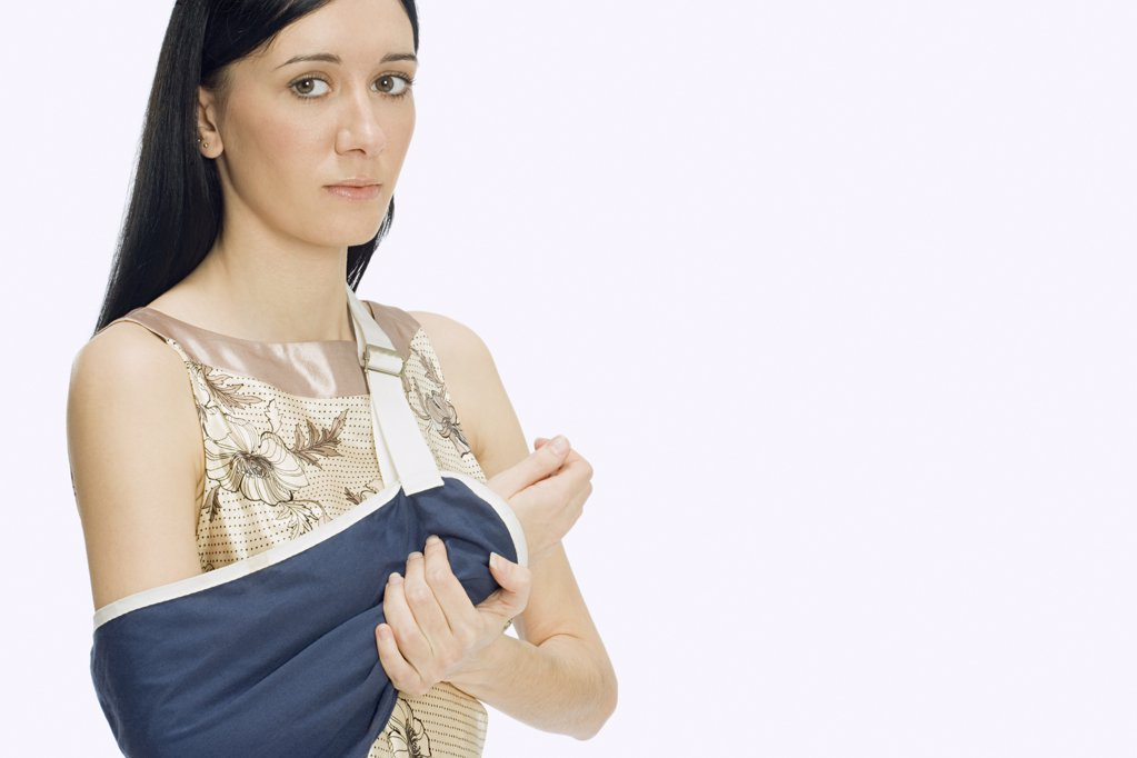 Stock Photo: 1439R-1032442 Woman wearing sling