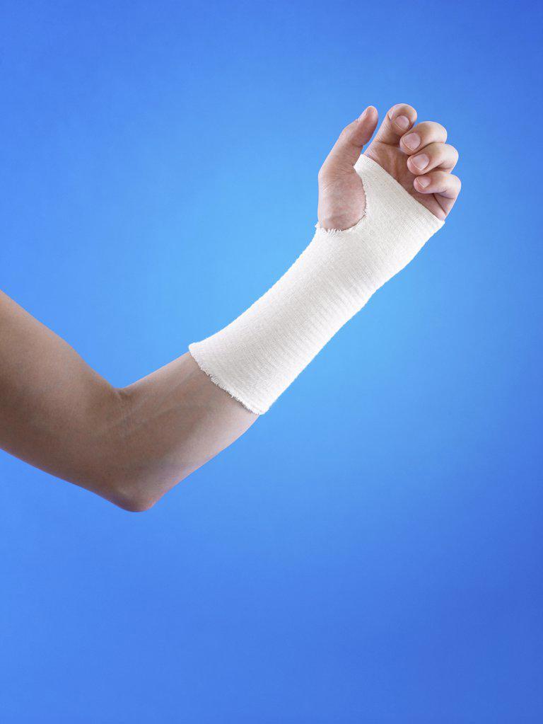 Man with bandage on wrist : Stock Photo